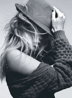 tousled hair, a big chunky sweater and a killer hat