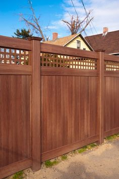 V3215SQ-6 6' High Vinyl Privacy Fence with Square Lattice and New England Post Caps in Grand Illusions Vinyl Woodbond Walnut grain (W103) A fence that looks beautiful even in the winter!