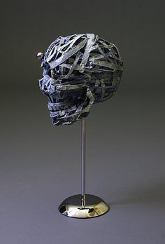 Skull - paper mache sculpture by Jud Turner - copyright 2011- super interesting process outlined through images- deconstructing object and reworking