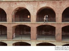 Fort Point in San Francisco is such a cool location for an engagement session! Loved their outfits! #FloralDress #Booties #RedShoes #EngagementPhotography #FortPoint #SanFrancisco