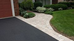 Half Circle Asphalt Driveways With Fieldstone Border