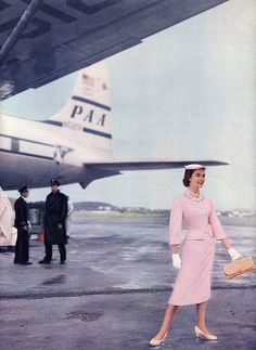 Pink Suit 1960s, with Pan Am DC-7 in the background. #aviationglamourpanam