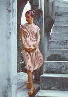 1946      Model is wearing a striped wrapped Empire dress of rayon jersey by Mildred Orrick.