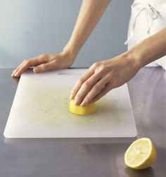Run the cut side of a lemon over the board to remove food stains and smells.