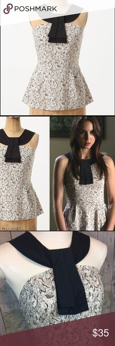 Anthro Neo Halter Tank This is a romantic vintage inspired tank by Girls From Savoy sold at Anthropologie.  It features a whimsical black & cream print with bold black halter neck with folds at the chest! So much fun to style in different ways! Anthropologie Tops