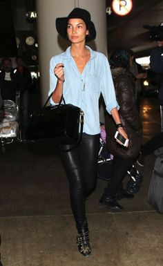 Lily Aldridge at the airport. You can never go wrong in chambray  leather.