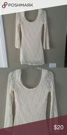 3/4 sleeve lace cream dress Never worn 3/4 sleeve cream dress. Great for a baby shower or bridal shower. 100% nylon. Dresses