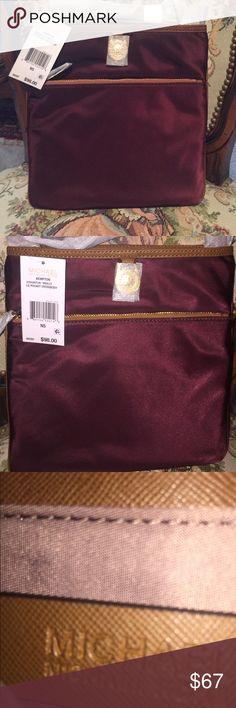"Michael Kors cross body purse (Merlot) Michael Kors Merlot colored, large cross body purse.   -100% Nylon  -Gold-Tone Hardware  -9 7/8"" X 1 1/8"" X 10 2/8""  -Adjustable Drop: 21""-23""  -Exterior: One Zip Pocket, One Open Pocket  -Interior: One Zip Pocket, Three Open Pockets  -Lining: 100% Nylon  -Imported Michael Kors Bags Crossbody Bags"