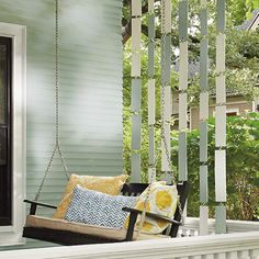 DIY porch divider provides a sense of privacy but is open and airy and can be painted any color combination to coordinate with decor. With downloadable instructions.