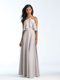A cropped ruffled bodice adds a modern touch to this halter gown. Allure Bridal Bridesmaid dress Style 1556 in Silver. Beautiful long flowing bridesmaid dress with a halter style neck and flowing fabric on tip. This figure flattering dress will look great on any body type.