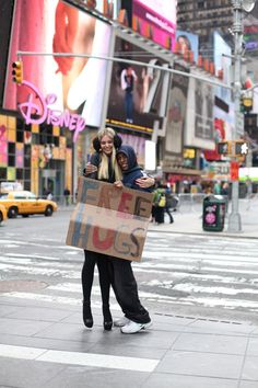 Spend a day holding up a free hugs sign in a big city.