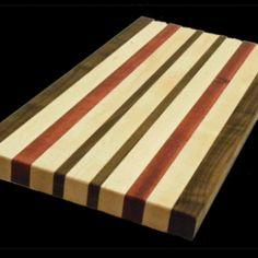 Handcrafted walnut, maple, & mahoghany cutting board