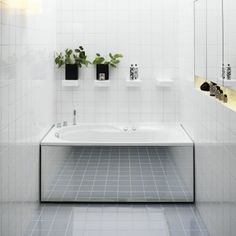 Mirrors, Mirrors on the Walls  For a very narrow bathroom, add a mirror to the tub's built-in side panel to make it appear larger. Keep othe...