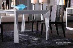812-180 Modern Armani Lacquer Table by VIG. $1797.00. The 812-180 Modern Armani Dining Table has some very interesting features that are worth mentioning. The first is its very interesting table leg pattern that makes use of wide bands twisted and turned for a very unuque look. The contemporary legs accent the table top that tapers to a narrow finish. White lacquer is used all around the table from the top to its twisting legs. This design will surely never go ...