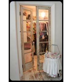 A set of truly vintage glass doors. You may be able to find some inexpensively at your local flea market, antique store or architectural salvage yard. Wardrobes are generally colorful and full of texture, so it certainly doesn't hurt to have them in full view through lovely glass doors.