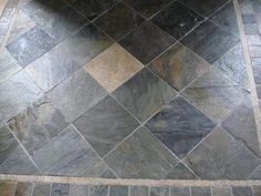 Slate tile flooring - on the diagonal - and note the small square details areound the edges