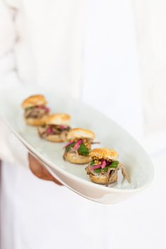 Tequila braised pork shoulder on buttermilk biscuit with whole grain mustard and pickled red onion @Taste Catering