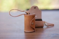 Hand crafted leather poop bag dispenser. Easily attaches to the handle of leash, belt loop, your wrist or anyway you like. Comes with a free roll of