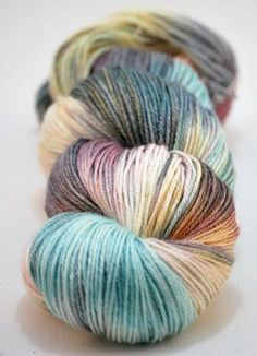 A teal and plum handpainted colourway with olive green shadows with lemon yellow & gold pink reflections 50% Superwash Merino / 50% Silk - 100g Approx 400m (437 yds) per 100g – Fingering/4ply sock weight This yarn has a soft, squishy feel and reflects light beautifully. Our silver range of silk/merino yarns are inspired by walks by the sea and the Irish countryside on wet and windy days, which we spend most of our time marvelling at the rockpools, the bright rows of towns houses and ...