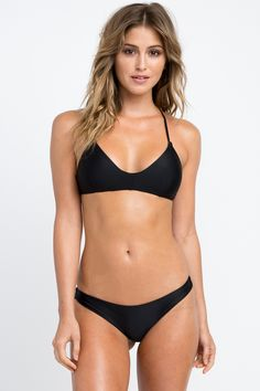The RVCA Solid Cross Back Top is a sporty bralette-style swim bikini top with a v-cut neckline and a crossed self-tie closure at the back. It has adjust...
