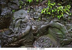 Artisans have carved the story of the RAMAYANA in stone along the banks of the AYUNG RIVER - UBUD, BALI, INDONESIA ...