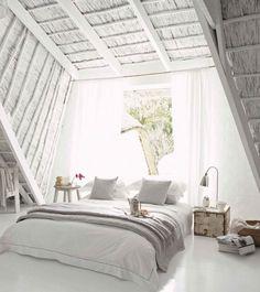 Dreamy all white attic bedroom
