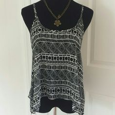 """Brandy Melville Silky Lightweight Open Back Tank 🎀🎉 Best in Tops Host Pick!! 🎉🎀 Super cute and boho style backless flowy tank from brandy melville. Never worn, in excellent condition. Sheer and lightweight, super flowy and comdortable. The mannequin is a true size M so could fit a S-L depending on the fit you're looking for. Price flexible, please feel free to make an offer using the """"offer"""" button ! I love negotiating price :) Brandy Melville Tops Tank Tops"""