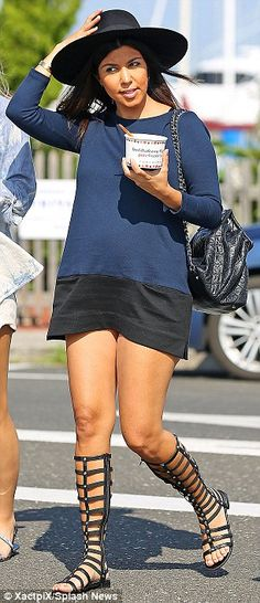 Sweet treat: Kourtney Kardashian, left, treated herself to frozen yogurt, as her sister Kh...