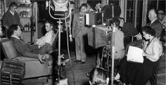 Alfred Hitchcock and staff on the set of Rear Window.