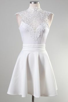 Lace trim on top with tie back sleeveless and flare dress. It would make my shoulders look even bigger, but I can always dream