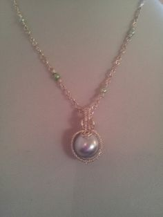 #Wire worked pale green glass pearl on a #handmade #silver plated chain sprinkled with more glass #pearls in #green