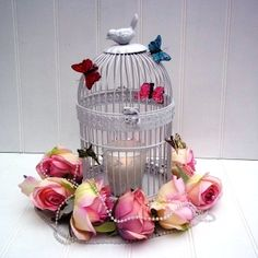 white metal birdcage lantern  with flowers and butterflies.
