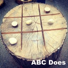 naughts and crosses made out of a tree stump #abcdoes