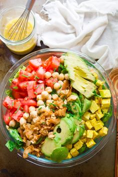 Juicy tomatoes, creamy avocado slices, hearty chickpeas, smoky coconut bacon, and savory tofu chunks are arranged atop crispy greens to make this flavor-packed and super satisfying vegan cobb salad. #vegan #veganfood #veganrecipes #vegetarian #vegetarianrecipes #salad #tofu #meatlessmonday