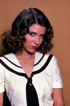 Carrie Fisher. In a nautical outfit. What's not to love?