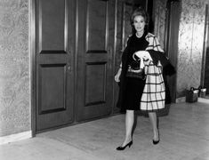 Babe Paley wearing White plaid coat over navy wool suit, 1963.