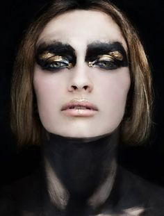 avant garde makeup. gold and black.