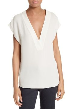 $255 Free shipping and returns on Theory Orwin Silk Georgette Blouse at Nordstrom.com. A deep-cut surplice V-neckline puts a modern spin on this soft and flowy blouse that pairs with nearly anything.
