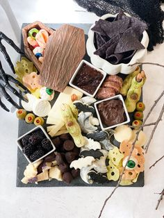 I love making this eerie board for easy snacking. It is the perfect precursor to our bacon wrapped Halloween meatloaf with ghost mashed potatoes or spooky ghost shepherds pie; two of our other Halloween favorites. Add our smoking Halloween mocktails and its the perfect spread!