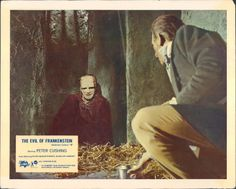 """UK Lobby Card for the Hammer horror film """"The Evil of Frankenstein"""" (1964), directed by Freddie Francis and starring Peter Cushing as the titular mad scientist. A film distribution deal allowed for a monster and sets that more closely resemble the Universal version starring Boris Karloff."""