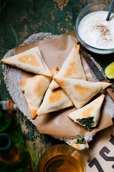 Spinach fatayer with beer and sour cream dip.