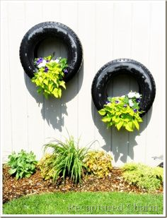 things to do with flower pots | Hanging Tire Flower Planters (finally something to do with all the ...