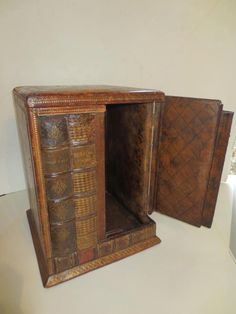 19th-century Italian wine box shaped like a small shelf of books with a complicated lift top . pinned with Pinvolve