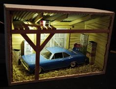 I wanted to put cars (1/43 scale) on display. I decided to use RIBBA frames because of nice appearance and dimensions and create a mini garage diorama.