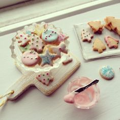 Tiny Christmas cookies 1:12 made by me. Each one is frosted by hand. Dollhouse miniatures