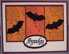 Spooky Halloween card.  Spider webs and bats.