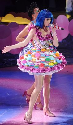 Katy Perry. She is like a real life cartoon character. Her costumes and music videos are just FUN!