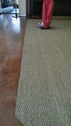 Beautiful installation of hardwood flooring and seagrass carpet.