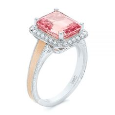 This stunning engagement ring features a large emerald cut peach sapphire surrounded by a rectangular diamond halo and a rose gold inlay on the shoulders of the vintage-inspired band. Designed and created by Joseph Jewelry Princess Cut Engagement Rings, Halo Diamond Engagement Ring, Peach Sapphire, Ideal Cut Diamond, Alternative Engagement Rings, Womens Wedding Bands, Engraved Jewelry, Retail Therapy, Emerald Cut