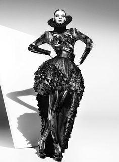 Model: Masha Tyelna  Hair: Irene Bussemaker  Bodysuit: CHAPURIN  Neck ruff/Shoes: Marko Mitanovski  Stylist: Alexia Somerville  Photographer: Nick Kelly